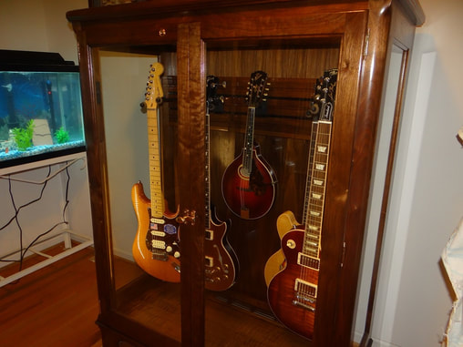 I Spent Yesterday Afternoon Getting The Cabinet Placed In My Home, The  String Swing Hangers Placed And My Guitars And Mandolin In Place.